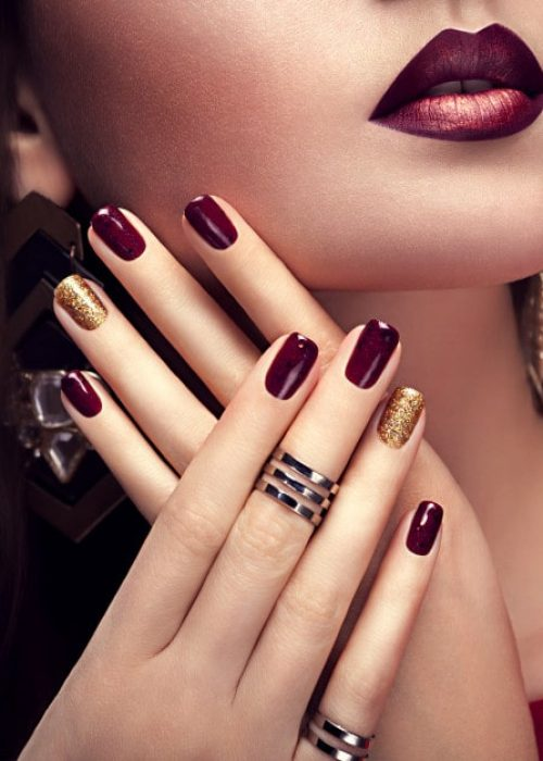 beautiful-woman-with-perfect-make-up-burgundy-golden-manicure_106029-60-min